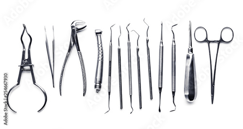 Fotografía  Different shiny metal medical tools isolated on white background