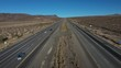 Aerial interstate freeway traffic Nevada California border fast pull 4K 207