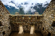 canvas print picture Sunshine breathtaking view of Machupicchu stone anchient walls and temple among mountains covered with clouds