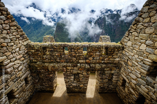 Sunshine breathtaking view of Machupicchu stone anchient walls and temple among Canvas
