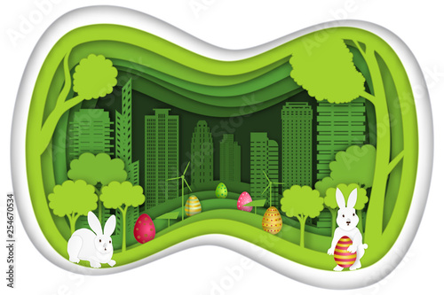 Fotografiet  Paper art , cut and craft style of colorful of eggs and rabbit in the green nature layer as Easter Holiday concept
