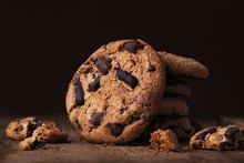 Chocolate Chip  Cookies On Wooden Table. Stack With  Chocolate Chip Cookies On Dark  Background With Copy Space For Text, Closeup.