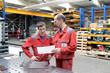 canvas print picture - Berufsausbildung im Handwerk - Azubi und Lehrmeister in der Werkstatt // Vocational training in the trade - apprentice and teacher in the workshop