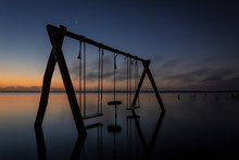 Lagoon Swing At Sunrise