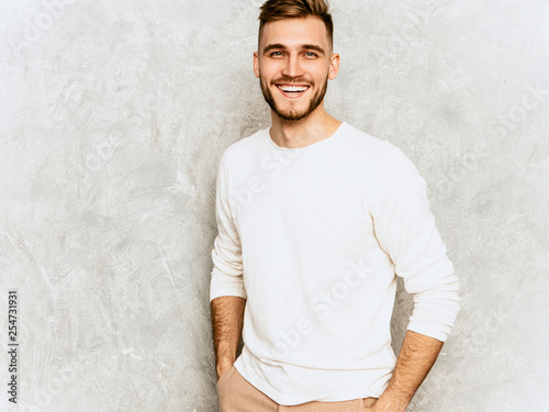 Fotografie, Obraz  Portrait of handsome smiling hipster lumbersexual businessman model wearing casual summer white clothes