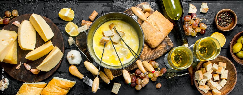 Fototapeta Delicious fondue cheese with white wine.