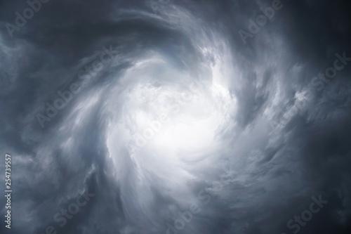 Dark, grim, stormy, rainy sky with rays of light Wallpaper Mural