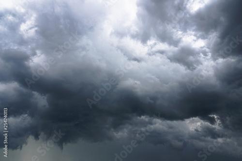 Canvas Print Dark, grim, stormy, rainy sky with rays of light