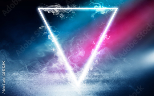Obraz Neon triangle shape in smoke on a dark background. Background of empty room with concrete floor, neon light - fototapety do salonu