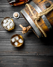 Whisky In Glasses And Barrel.