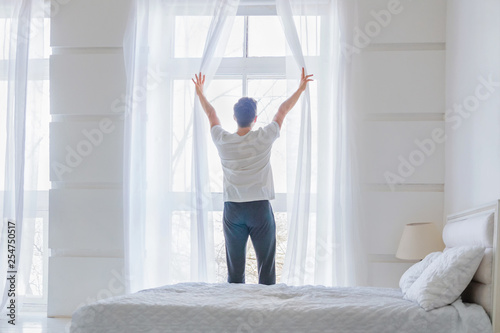 Fotografie, Obraz  Young man near window at modern home