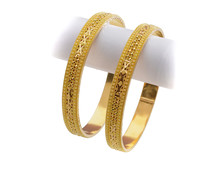 22k Gold Bangle On White Background
