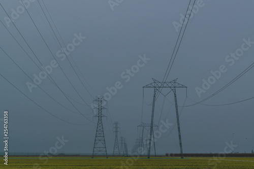 Fotografie, Obraz  Power lines across a farm field
