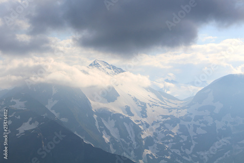 Garden Poster Scandinavia view of mountains and clouds in sky