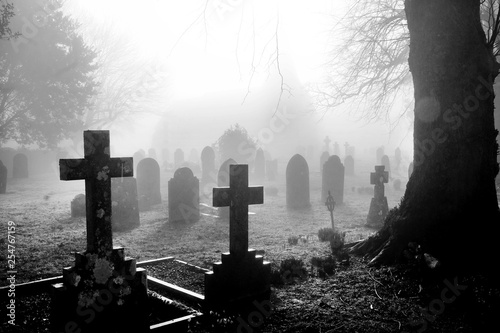 Photo black and white photograph of an English grave yard covered in thick fog