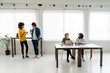 Young business people working together in coworking space