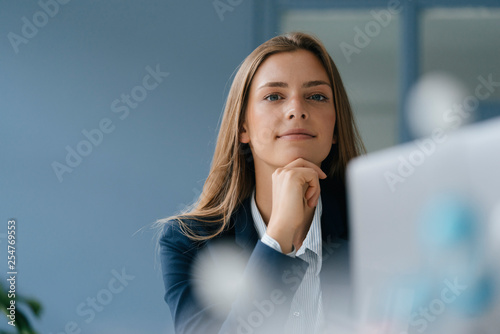 Portrait of young businessw...