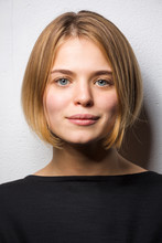Portrait Of Blond Young Woman With Bob Hairdo