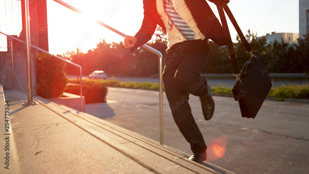 Fototapety, obrazy: CLOSE UP: Young businessman running late to important meeting on sunny morning.