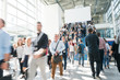 Leinwanddruck Bild blurred people at a trade fair