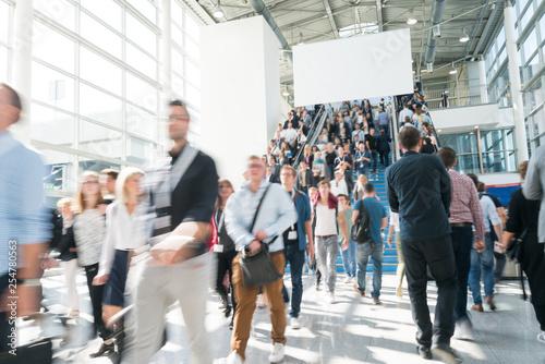 Valokuva blurred people at a trade fair