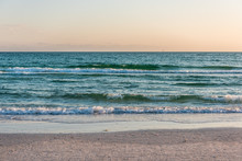 Wave With Horizon On Shore In Siesta Key, Sarasota, Florida During Dark Evening Sunset With Water Wet Sand Tide Pool And Nobody