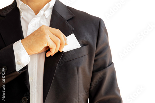 Obraz na płótnie Businessman taking out business card from his suit pocket isolated clpping path