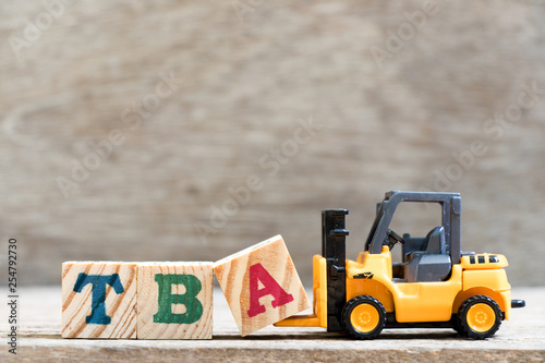 Toy forklift hold letter block  in word TBA (abbreviation of to be announced) on Canvas Print