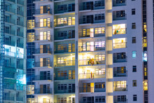 City Apartment Windows At Night.  Residential Highrise Residences For Metro Housing In Urban Environment.
