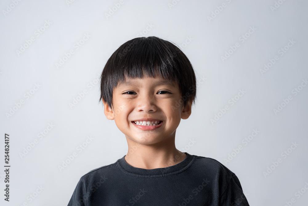 Fototapeta portrait of cute boy smiling, asian boy on white background