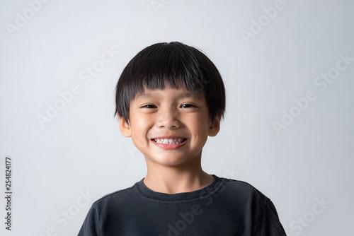Fototapeta portrait of cute boy smiling, asian boy on white background obraz