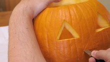 Man Carves A Nose In A Pumpkin...