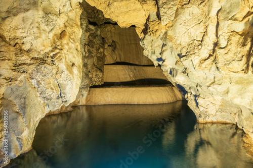 Cave lake nature background.