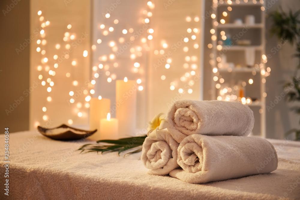 Rolled towels on table in spa salon