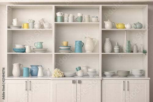 Cupboard with clean dishes in kitchen Wallpaper Mural