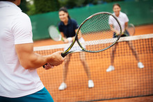 Group Of Healthy Happy Friends At The Club Playing Tennis
