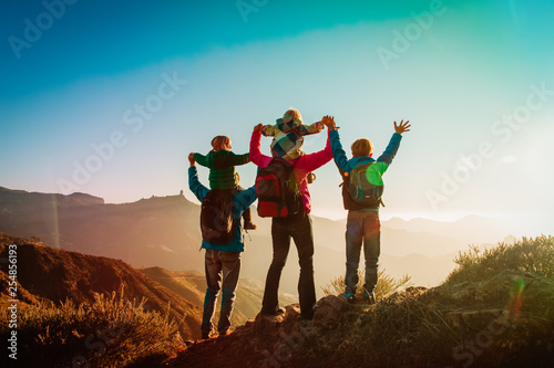 Fotografie, Obraz  happy family travel in mountains at sunset