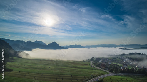 Foto op Plexiglas Blauwe hemel Sromowce Wyżne in the clouds with mountain panorama aerial view