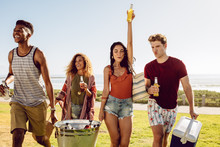Multi-ethnic Group Of Friends Going On Picnic