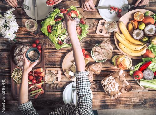 Foto op Canvas Kruidenierswinkel Enjoying dinner with friends. Top view of group of people having dinner together