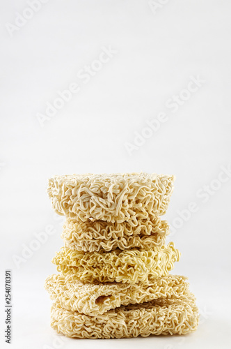 Fotografie, Obraz  Heap of different Asian raw dried egg noodles on white background