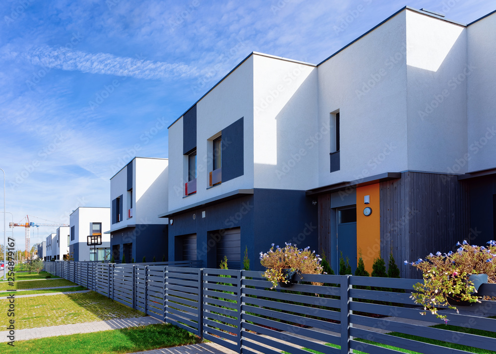Fototapeta Apartment house and home residential building complex with gate