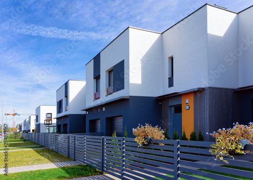 Obraz Apartment house and home residential building complex with gate - fototapety do salonu