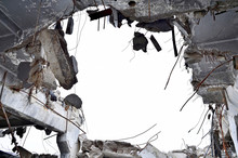 Punched A Huge Hole In The Basement Of A Large Destroyed Concrete Building. Bottom View, Space For Text