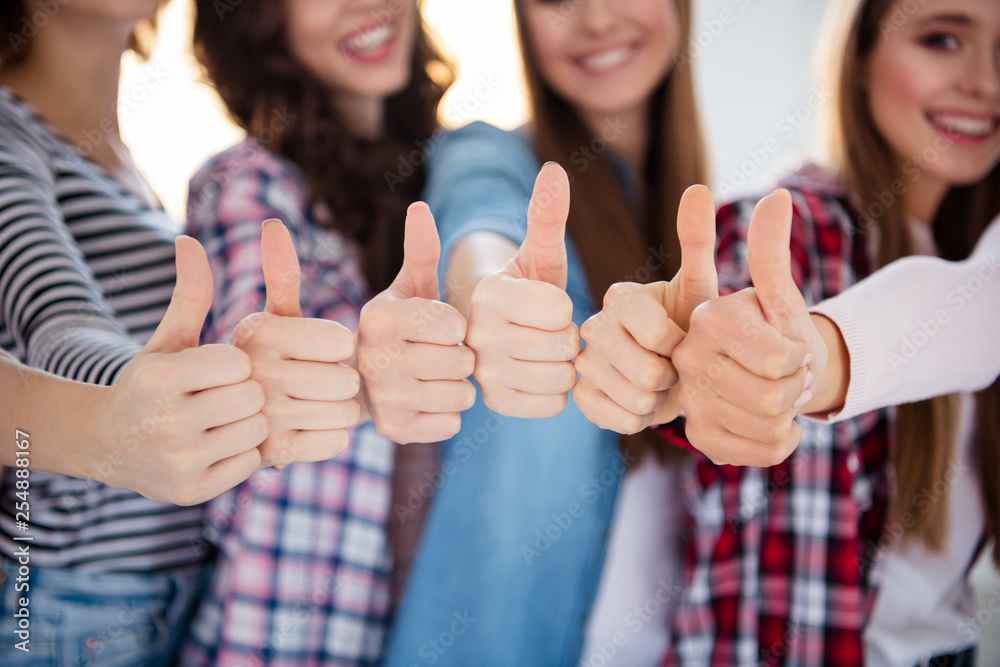 Fototapety, obrazy: Cropped close-up view of nice charming attractive cheerful cheery successful ladies showing thumbup ad advert advice glad good education study a-mark academic in light white interior room indoors