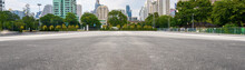 Empty Asphalt Road With City I...