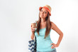 Morning refreshment. Woman in hat standing studio isolated on white with beach bag drinking cup of coffee posing to camera joyful