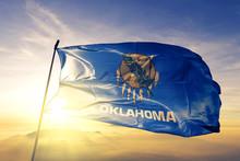 Oklahoma State Of United States Flag Waving On The Top Sunrise Mist Fog