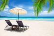 Beach chairs with umbrella and beautiful sand beach