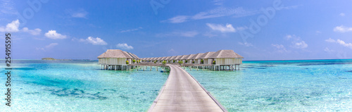 Landscape of Maldives beach. Tropical panorama, luxury water villa resort with wooden pier or jetty. Luxury travel destination background for summer holiday and vacation concept